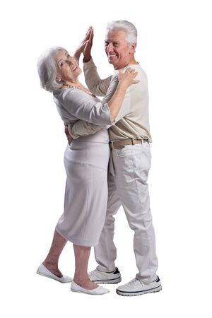 Happy senior couple dancing isolated on white background