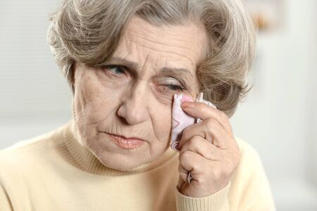 Portrait of a stressed senior woman crying