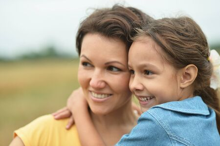 Happy mother and daughter at summer field Stockfoto