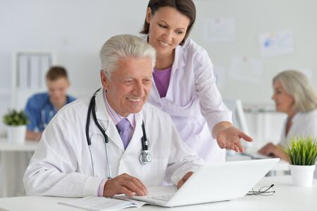 Portrait of professional doctors working in cabinet