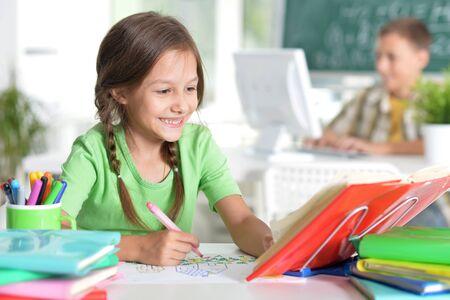 Portrait of cute teen girl doing homework in her room 版權商用圖片