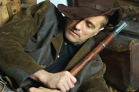 Bandit with gun in the wild west sleeping