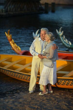 Senior couple standing at the resort during vacation