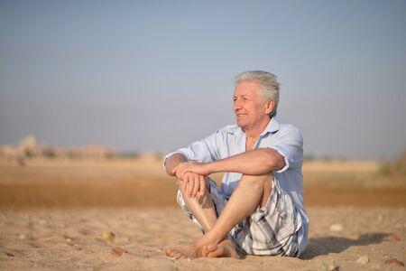 Portrait of happy senior man at tropical resort