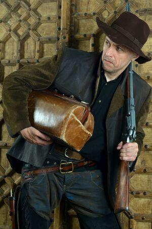 Bandit with gun in the wild west