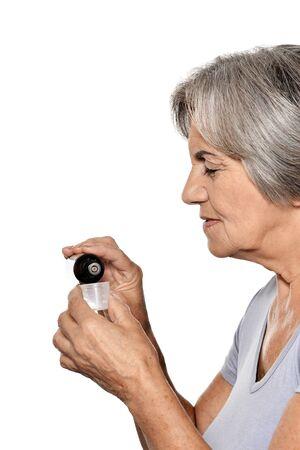 Ill beautiful senior woman isolated on white background isolated Stockfoto