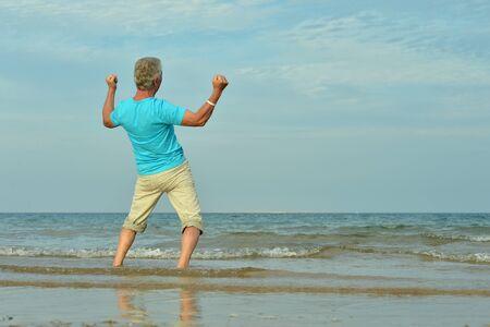 Portrait of senior man at tropical resort