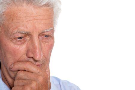 Portrait of sad senior man isolated on white background Stockfoto