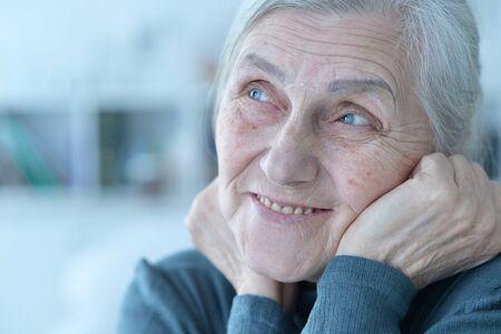 Portrait of happy senior woman posing at home