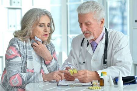 Close-up portrait of senior doctor with elderly patient
