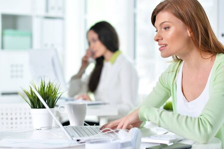 Two young businesswomen working at modern office