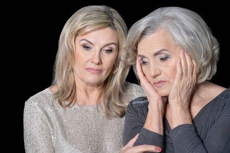 Portrait of a two sad women posing