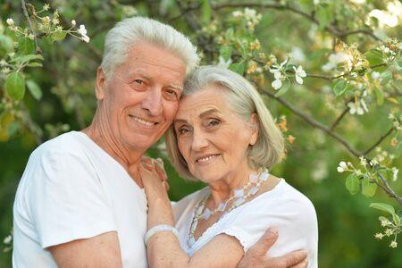 Portrait of beautiful senior couple posing in the park