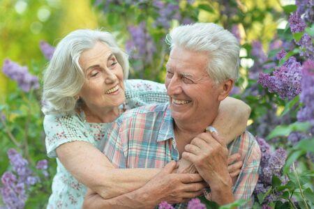 Beautiful senior couple hugging in the park