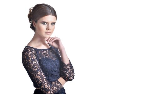 Beautiful young woman posing isolated on white background