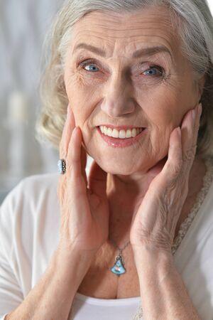 Portrait of beautiful senior woman posing at home