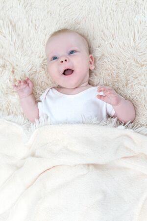 Cute little baby girl lying under the blanket Reklamní fotografie