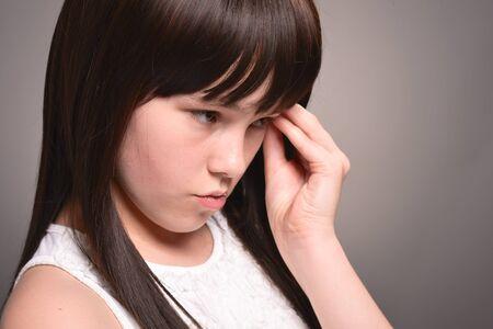 Portrait of cute girl with dark hair posing Stockfoto