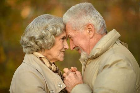 Beautiful senior couple posing in the park