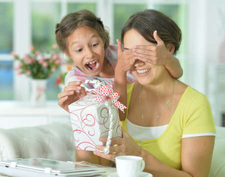 Cute girl prepared surprise to her mother