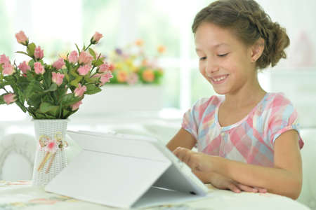 Portrait of beautiful girl with tablet pc