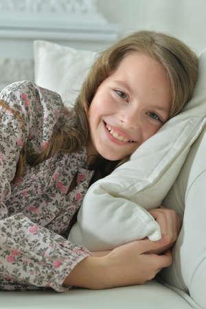 Portrait of ute little girl on sofa