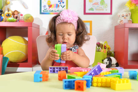 Portrait of little baby girl with toys