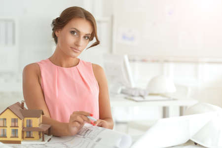 Beautiful young businesswoman architect working in office