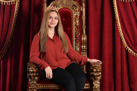 Portrait of queen with crown on chair