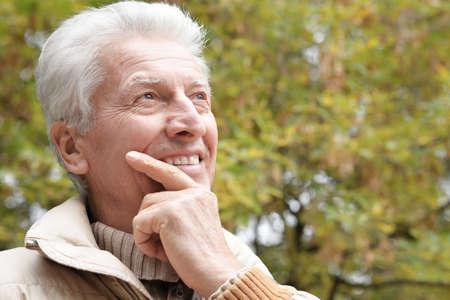 Portrait of happy senior man in park