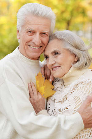 Beautiful senior couple embracing in the park
