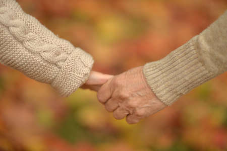 Granddaughter and grandmother holding hands close up Foto de archivo