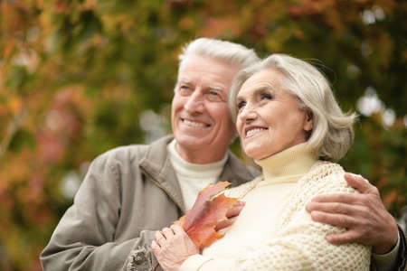 Beautiful senior couple smiling in the park