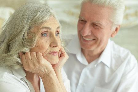 Close-up portrait of happy senior couple posing