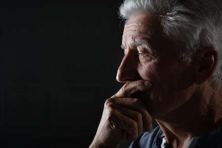 Portrait of a sad thinking senior man
