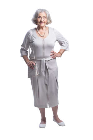 Beautiful senior woman posing against white background