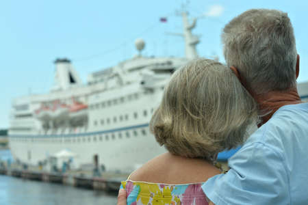 Portrait of senior couple sitting by ship