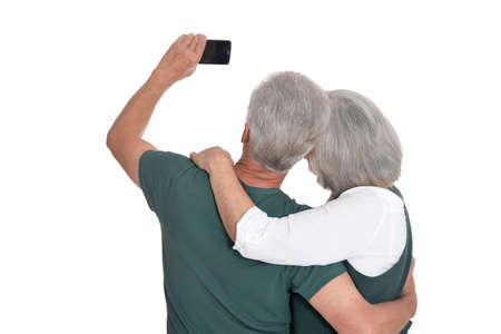 Portrait of a senior couple taking selfie