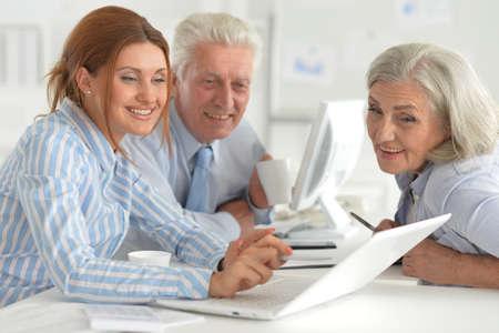 Portrait of businesspeople working in modern light office