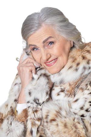 Portrait of happy beautiful senior woman in fur coat