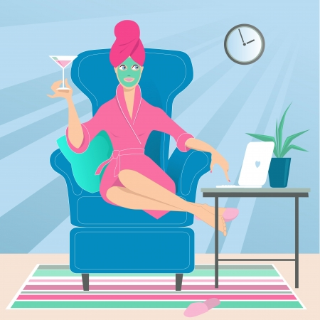 ideal: Woman in a bathrobe with a towel on her head and a drink in her hand working on a laptop from her home, sitting in a comfortable chair