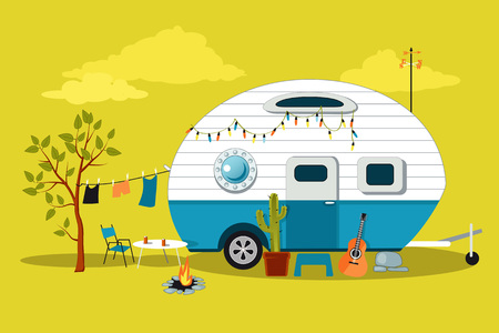 Cartoon travelling scene with a vintage camper, a fire pit, camping table and laundry line