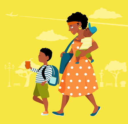 black boys: Young black mother with two boys walking in a park
