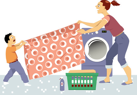 Young woman and little boy folding laundry together in a laundry room