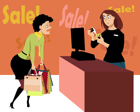 Sales associate at the cash register cutting a credit card of a female customer, holding a number of shopping bags