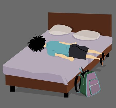 Exhausted and depressed child lying face down on a bed with his school backpack