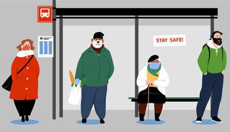 People waiting on a city bus stop wearing face coverage and maintaining physical distance