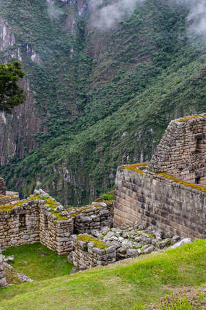 Vertical viiew of ruins of Machu Picchu Inca culture on a cliff in the Andes mountains. Peru. South America. No people. 写真素材 - 104761292