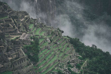 Beautiful background image of ancient stone ruins of Machu Picchu in the wild nature of the mountains with clouds. Peru. No people. 写真素材