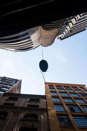 Urban illumination between old office buildings in downtown. Standard-Bild
